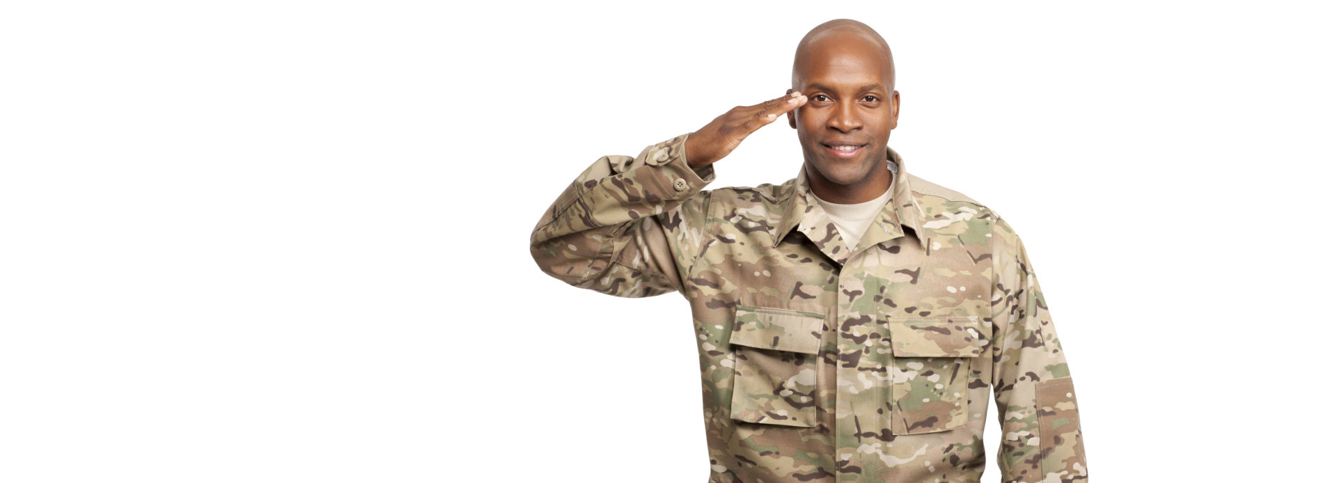 smiling army man doing a salute