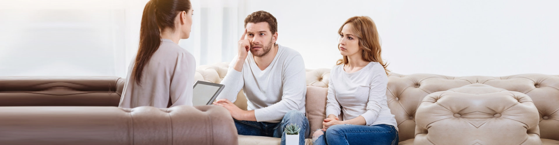 troubled couple listening closely to their therapist